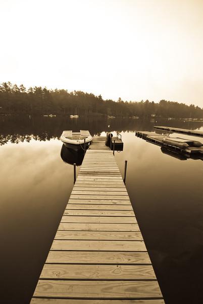 Dock on Sebago Lake with the water like glass.