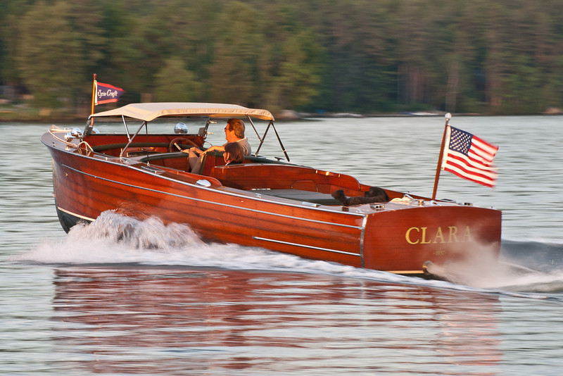 Classic Chris Craft boat in Meredith Bay on Lake Winnipesaukee.