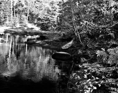 Black and White Lonely Boat in a small cove in Maine