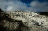 Striking clouds add to the strange beauty of Mammoth Hot Springs.<br /> Photo © Cindy Clark