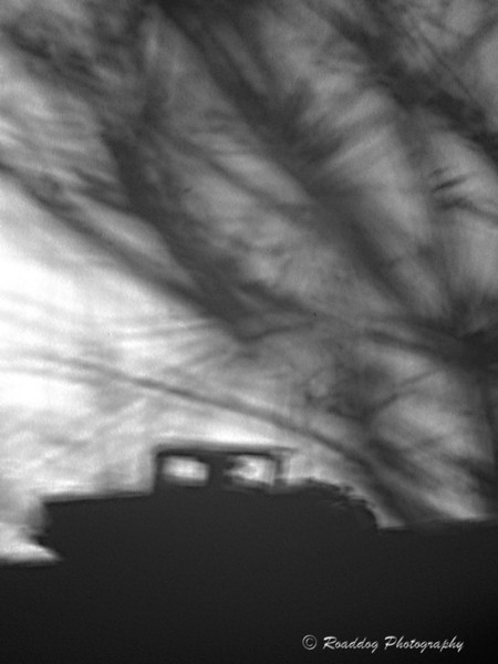 Shadow Dance. <br /> <br /> Cell phone image of shadows on my office wall.