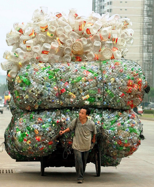A Chinese man transports plastic bottles and containers for recycling in Haikou, the capital of China's southern Hainan province. REUTERS