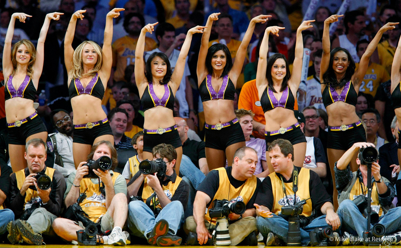 Los Angeles Laker Girls perform behind photographers on the sidelines during Game 2 of the NBA Finals between the Los Angeles Lakers and the Orlando Magic in Los Angeles June 7, 2009.     REUTERS/Mike Blake