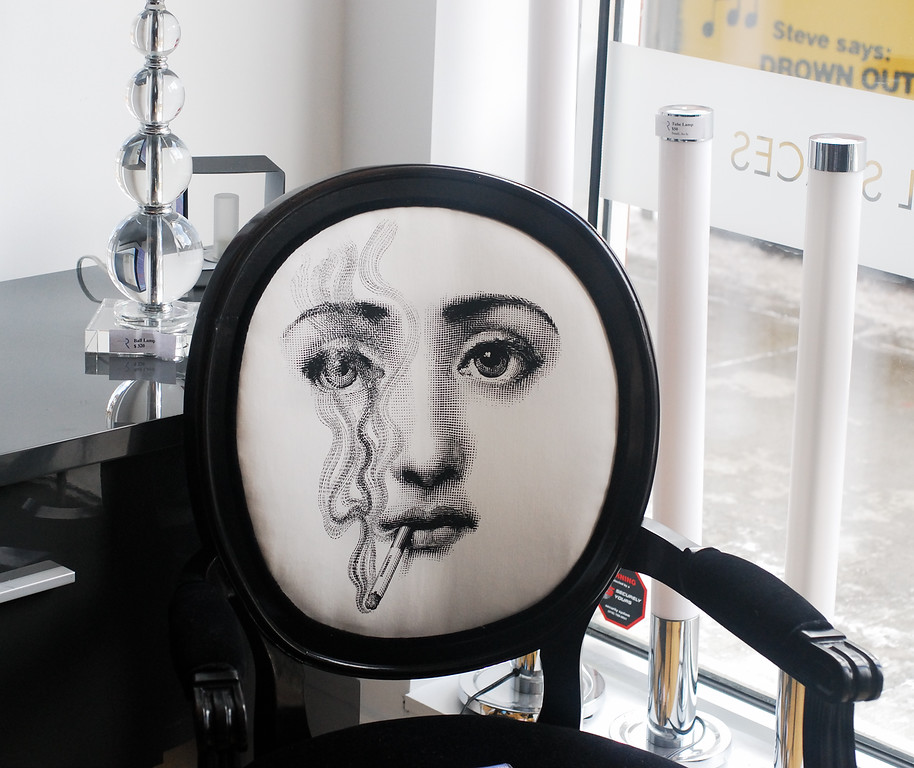 $2100 for this chair.Piero Fornasetti type design