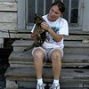 This lady's family has lived for generations in New Orleans. Her grandmother raised a dozen children in the house next door which burned after Katrina due to arson. Both her dogs perished in the flames but this kitty made it through everything.