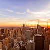 <h2>New York City Skyline -  Sunset over Midtown</h2> - By Vivienne Gucwa<br><br>  New York City sunsets are songs.<br><br>  They remind you of all of the times <br><br>  you ran with open arms <br><br>  into a city that embraced you back <br><br>  on the whisper of a breeze <br><br>  in a skyline reflected in glistening eyes <br><br>  wide with hope. <br><br>  And everyday <br><br>  carries the promise <br><br>  of a new song.<br><br>  ---<br><br>  This image was taken from the top of Rockefeller Center (Top of the Rock) during an absolutely gorgeous sunset. The view is of the skyscrapers and rooftops of the midtown Manhattan skyline looking south including the Empire State Building, Chrysler Building, and 1 World Trade Center.<br><br>  ---