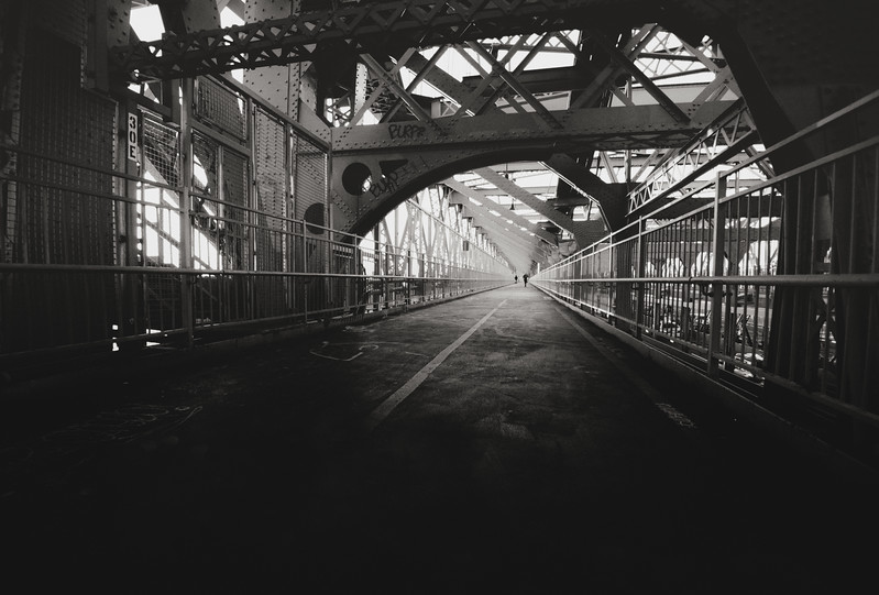 Willamsburg Bridge - New York City - By Vivienne Gucwa  This was taken on a frigid, moody day in the winter looking down the pedestrian walkway of the Williamsburg Bridge in New York City.   The Williamsburg Bridge connects the Lower East Side in Manhattan with Williamsburg in Brooklyn.    ---