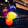<h2>East Village Balloons - St. Mark's Place - New York City</h2> - By Vivienne Gucwa  Festive colorful party balloons blow in the wind on St. Mark's Place in the East Village, a popular neighborhood in lower Manhattan.  ---