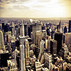 <h2>New York City Skyline - Chrysler Building and Skyscrapers</h2> - By Vivienne Gucwa  Looking out over New York City from up high, the skyscrapers rise from the ground proudly as if they are marching towards the horizon where the city and the sky meet briefly and where steel dissolves into light.  --  This particular cityscape features the skyscrapers of midtown Manhattan including the MetLife building and the Chrysler Building. To the right of the Chrysler Building is the 59th Street Bridge (also referred to as the Ed Koch Queensboro Bridge) and beyond the skyscrapers in the foreground sits Central Park and midtown east.  ---