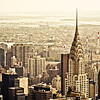 <h2>The New York City Skyline and the Chrysler Building</h2>- By Vivienne Gucwa<br><br>  I have always been partial to late summer skyline views here in New York City.   The haze that hangs over the horizon like a misty veil seems to lend a special sort of immediacy to the skyscrapers that assert themselves in the foreground. <br><br>  The Chrysler Building, New York City's art-deco masterpiece of architecture, always looks so regal positioned in front of the Ed Koch Queensboro Bridge (also known as the 59th Street Bridge). Four smokestacks playfully draw the eye towards the rest of Queens that sprawls out in the distance towards the fading horizon. <br><br>  It's as if the sky is locked in an embrace with the rest of the city while the skyscrapers that make up the midtown Manhattan skyline are enraptured and wrapped up in their own special moment with the Chrysler Building. <br><br>  ----