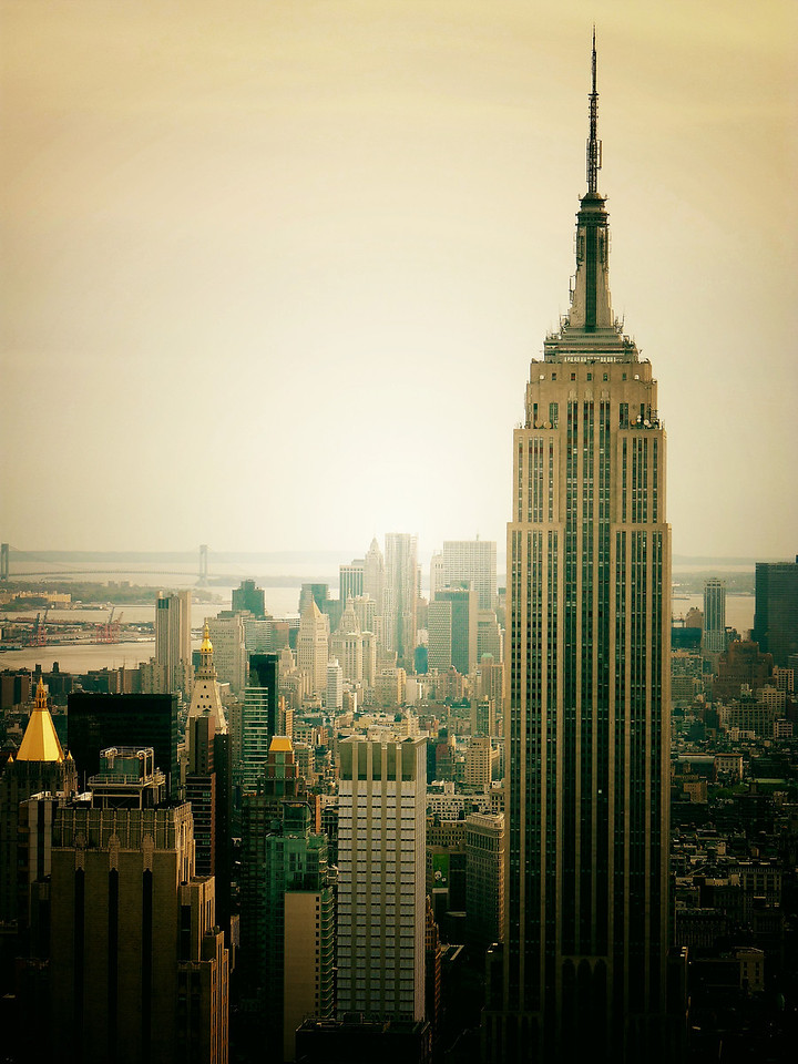 <h2>Perspective - The Empire State Building and the New York City Skyline</h2> - By Vivienne Gucwa  The Empire State Building was designed (from the top down) by William F. Lamb from the architectural firm Shreve, Lamb and Harmon, which produced the building drawings in just two weeks, using earlier designs as a basis. The building was officially opened on May 1, 1931 in dramatic fashion, when United States President Herbert Hoover turned on the building's lights with the push of a button from Washington, D.C.  It was the first building to have more than 100 floors.  ---
