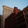 <h2>Flatiron Building - New York City </h2> - By Vivienne Gucwa  Dusk is the day's love letter to a night that slow dances across the sky.   ---  This is a view of the Flatiron Building, one of New York City's most popular skyscrapers. I love this particular view at dusk when the city's lights start coming into the view as the sky gradually darkens. The early evening light really brings out the gorgeous red tones of the building that is directly next to the Flatiron Building in this view. The red building was the original Western Union building. It was built in the late 1800s and was initially connected via a series of tubes to the company's original headquarters located 2 miles downtown on Broadway. The architect who designed it, Henry J. Hardenbergh, was the same architect responsible for the Dakota, and Plaza Hotel.    ---
