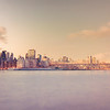 <h2>New York City Skyline and Queensboro Bridge - Dusk</h2> - By Vivienne Gucwa<br><br>  It happens like this:<br><br>  You squint your eyes open <br><br>  after walking on clouds in last night's dreams <br><br>  and the city comes into view:<br><br>  a vast glistening kingdom built on the the shoulders of despair and joy. <br><br>  As the city comes into focus slowly, <br><br>  you shut your eyes abruptly<br><br>  sending up every wish that rests on the tip of your tongue <br><br>  soaring on the barest whisper of a breeze<br><br>  up towards the sky.<br><br>  And then you blink your eyes open<br><br>  hoping none of this <br><br>  was in vain. <br><br>  It wasn't.<br><br>   ---<br><br>  This is a view of the Queensboro Bridge (also known as the Ed Koch Queensboro Bridge, 59th Street Bridge, and a host of other names) and the skyscrapers of midtown Manhattan. <br><br>  ---<br><br>
