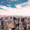 <h2>New York City Skyline - Central Park and Skyscrapers from Above </h2> - By Vivienne Gucwa  When the day stretches out  leaving a trail of sighs   in its wake,   the sky   and the infinite  slowly implode  folding themselves into one another  until all that is left  is a never-ending horizon  reaching out towards  the rest of forever.  ---  This is a view of Central Park and the skyscrapers of midtown Manhattan as seen from above. It was taken from the top of the Empire State Building on an impossibly perfect morning. Upper Manhattan sits in the distance with the Chrysler Building and Queens to the right. The trees of Bryant Park are peeking out in the bottom-left part of this image.  ---
