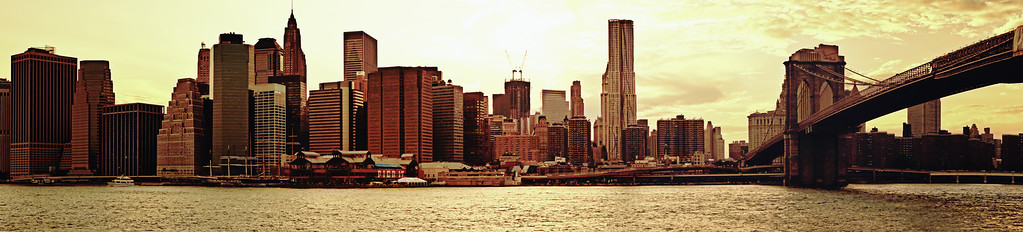<h2> The Brooklyn Bridge and the New York City Skyline Panorama</h2> - By Vivienne Gucwa  Looking towards the lower Manhattan Skyline, Pier 17, the South Street Seaport and the Brooklyn Bridge as seen from the river.  If you are interested in viewing a large version of this (since I have that disabled here), you can view it on Flickr here to see the details:   http://www.flickr.com/photos/vivnsect/7565528582/in/photostream/lightbox/   ---