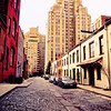 """<h2>Washington Mews - Greenwich Village - New York City</h2> - By Vivienne Gucwa  There are streets that I revisit with regularity. These streets seem to call me back again and again. Tucked away and nearly hidden, they are treasure chests that open to reveal a wealth of nostalgia with every passing season. I used to come to this particular street quite a bit but it wasn't until a year or so ago that I learned about its history.  The street sits on land that in the 18th century was part of a large farm and contained private stables used by the families of men such as nineteenth century architect Richard Morris Hunt, John Taylor Johnston who was the founding president of the Metropolitan Museum of Art , and Pierre Lorillard who was a prominent American tobacco manufacturer.  In the first half of the 20th century, a community of about 200 painters and sculptors flourished on this particular street and another adjoining street in the area. In 1903, a reporter for the New York Tribune wrote: """"One finds a strange mixture of bales of hay and enormous blocks of marble, boxes of plaster and barrels of oats littering the roadways. Truckmen in greasy jumpers touch elbows now and then with the sculptors in their clay spattered working garb.""""  One of the more prominent artists who had a studio on this beautiful street was Edward Hopper. Edward Hopper lived close to Washington Mews at 3 Washington Square starting in December 1913 until his death in 1967.  ---"""