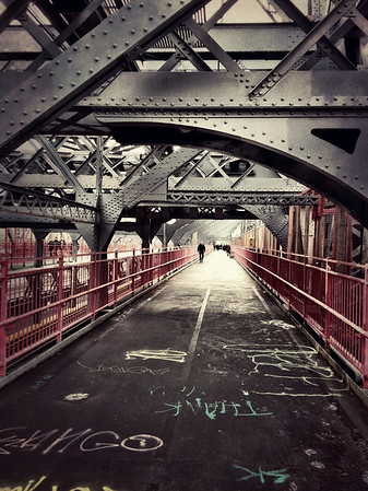 <h2>Williamsburg Bridge - New York City</h2> - By Vivienne Gucwa  Looking down the pedestrian walkway of the Williamsburg Bridge located in New York City. The Williamsburg Bridge connects lower Manhattan with Williamsburg Brooklyn and carries automobile and subway traffic in addition to foot traffic.The main span of this suspension bridge is 1,600 feet (490 m) long.   ---
