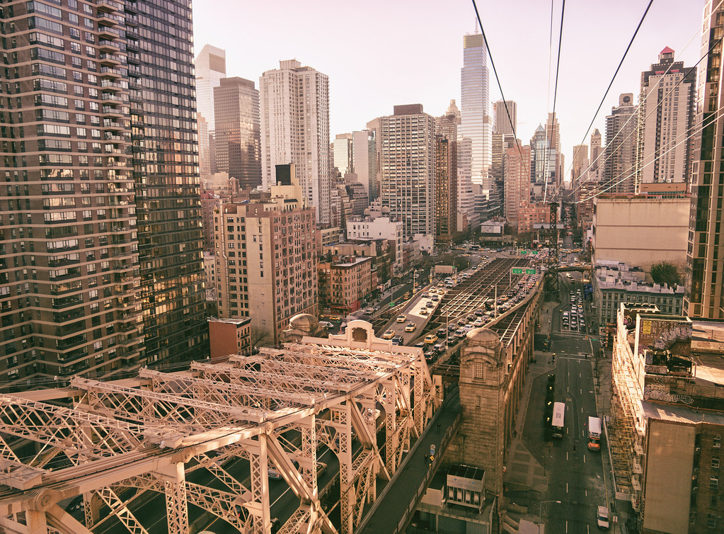 <h2>New York City from Above - Midtown Skyscrapers and Queensboro Bridge </h2> - By Vivienne Gucwa  This is a view of the entrance to the Queensboro Bridge (also known as the Ed Koch Queensboro Bridge, 59th Street Bridge, and Queens Bridge) and the skyscrapers of the New York City skyline in midtown Manhattan close to 59th Street on the east side. The vantage point is from the Roosevelt Island Tram, a tram that crosses from midtown Manhattan to Roosevelt Island a few times an hour which also offers breathtaking views of New York City.   ---