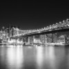 <h2>New York City - Night Cityscape - Queensboro Bridge  </h2> - By Vivienne Gucwa<br><br>  At night, the city's lights shine<br><br>  like stars in a massive urban universe.<br><br>  And as its supernovas explode<br><br>  shedding their light<br><br>  onto the surface of the water,<br><br>  the night sky looks on in wonder.<br><br>  ---<br><br>  This is a view of the Queensboro Bridge (also known as the 59th Street Bridge, Ed Koch Queensboro Bridge, and Queens Bridge) and the skyscrapers of midtown Manhattan as seen from Roosevelt Island. <br><br>   ---<br><br>