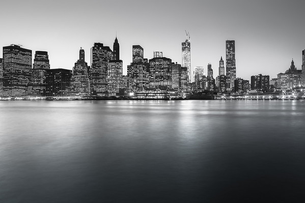 <h2>New York City Skyline - Financial District Skyscrapers</h2> - By Vivienne Gucwa  In the winter, there is a clarity and edge that is carried on the frigid fingers of icy air and crystallized exhales.  --  This is a view of the lower Manhattan skyline featuring the skyscrapers of the Financial District and Pier 17. The Freedom Tower (also known as 1 WTC or One World Trade Center), Woolworth Building, New York by Gehry, and the spire of the Municipal Building can all be seen here.   ---