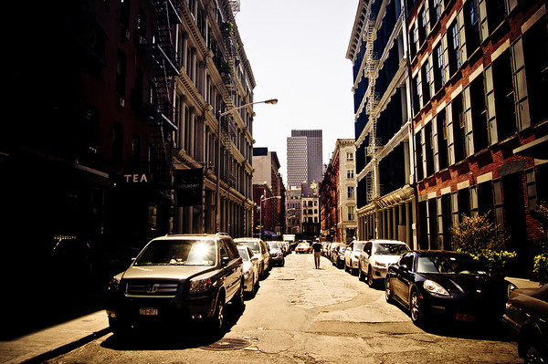 <h2>Urban Mirages - Soho Street - New York City</h2> - By Vivienne Gucwa   In the bright afternoon light of the sun, the city squints its eyes momentarily.  Buildings emerge from their slumbering shadows and streets glisten.  It's during this momentary squint that every sun gleam and distant figure on each sun-kissed street flicker in and out of view: urban mirages filtered through the eyes of the city.  ---