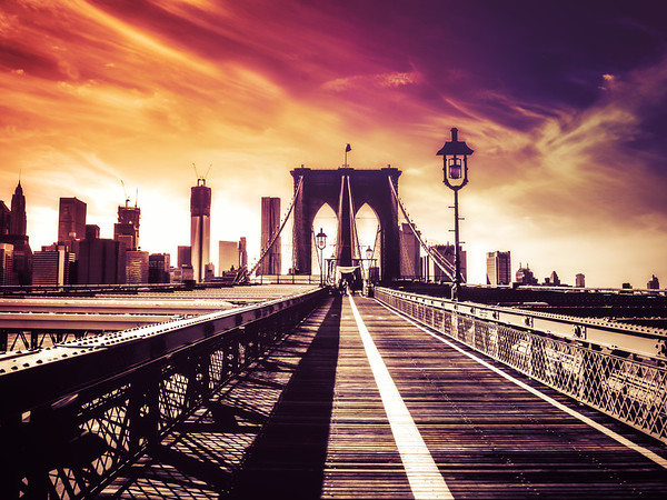 <h2>The Brooklyn Bridge and the New York City Skyline</h2> - By Vivienne Gucwa<br><br>  On hazy summer afternoons when dusk pulls its soft purple veil over the city, the skyline softens in the dreamy-eyed gaze of the clouds.<br><br>  And as light slides from the sky making its way over steel, wood and concrete towards the disintegrating horizon, bridges and skyscrapers melt with the sun into the evening. <br><br>  ---<br><br>