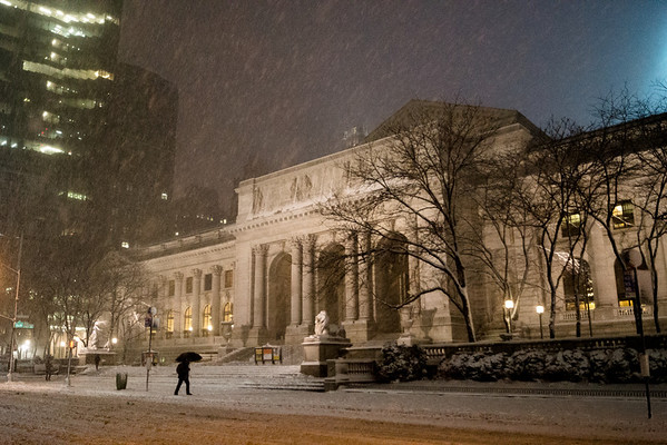<h2>New York Winter Night - New York Public Library 5th Avenue in the Snow</h2> - By Vivienne Gucwa  A person walks under cover of an umbrella under falling snow on 5th Avenue in front of the beautiful Beaux Arts architecture of the New York Public Library in midtown Manhattan at night. Taken during winter storm Nemo, the snow created a magical atmosphere as it blanketed New York City.   ---