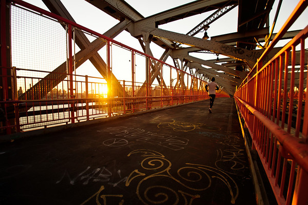 <h2>Williamsburg Bridge Sunset - New York City</h2> - By Vivienne Gucwa  When the sun sets in the winter, its light pours over the city like the glow from a distant bonfire with scattered light illuminating the grey, steel edges like embers strewn about in the wind.  ---  The Williamsburg Bridge is a favorite of mine in lower Manhattan. It tends to be overshadowed by the Brooklyn Bridge and Manhattan Bridge when it comes to popularity. This is probably because its pedestrian walkway is completely enclosed by a metal gate and because it isn't in super close proximity to the other two bridges (although one could argue that the pedestrian entrances to all three bridges are in walking distance to each other). However, it definitely lives up to its National Historic Civil Engineering Landmark status. Its architecture is incredible and the views of the New York City skyline and Brooklyn that can be glimpsed from either walkway are stunning.   ---