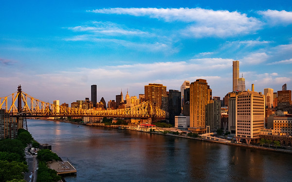 Queensborough Bridge and Manhattan Skyline at Sunrise from Roosevelt Island, New York City