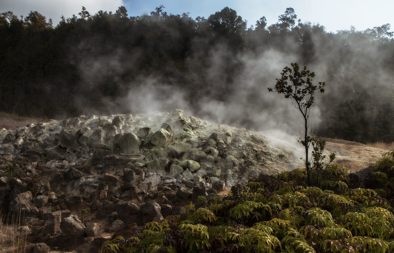 Steam rises from sulphur-coated rocks at Volcano National Park on the Big Island.<br /> Photo © Cindy Clark