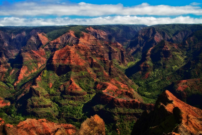 Intense color and dramatic landscape of Waimea Canyon on Kauai.<br /> Photo © Carl Clark