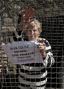 88 year old Joan Court a long time animal defender for PETA (people for the ethical treatment of animals) protested against the experimentation on Felix a macaque monkey by researchers at Oxford university. Joan donned a prisoners uniform and entered a small cage where she states she will remain for two days, she will also fast for the two days.