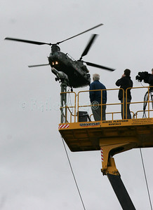 Gleneagles G8 Summit Wednesday 6th July 2005 a Chinook carrying police reinforcements flys over a tv platform
