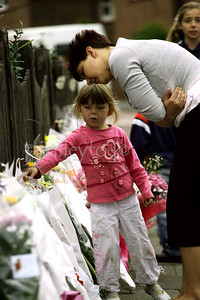 The scene where a  woman was killed and two children injured when a Jeep Cherokee that was being chased by police apparently mounted the pavement in St. Lukes Road, Pennywell, Sunderland. Members of the community laid floral tributes today 22 September 2006