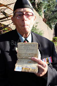 An old soldier shows off his Army Paybook which has his discharge date displayed, Rememberance Sunday 2005