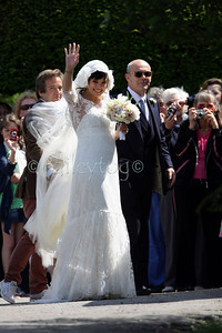 Lily Allen arrives at the church for her wedding accompanied by her father Keith