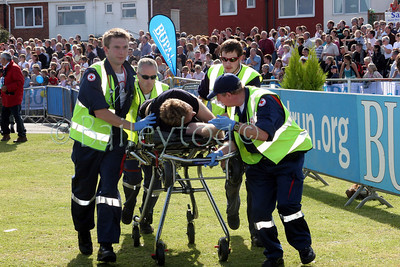 Paramedics carry a competitor, who had collapsed near the to the end of the race, towards the finish line of the Great North Run on Sunday 18th September 2005