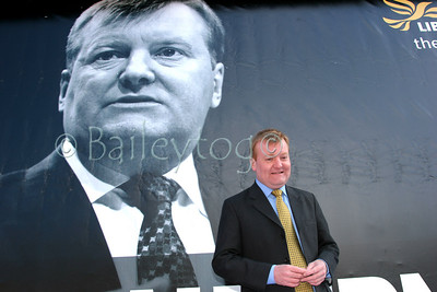Charles Kennedy MP poses in front of a poster of himself during a visit to Newcastle during the 2006 elections