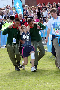 Soldiers of the Ghurka Regiment carry a competitor, who had collapsed near the to the end of the race, towards the finish line of the Great North Run on Sunday 18th September 2005