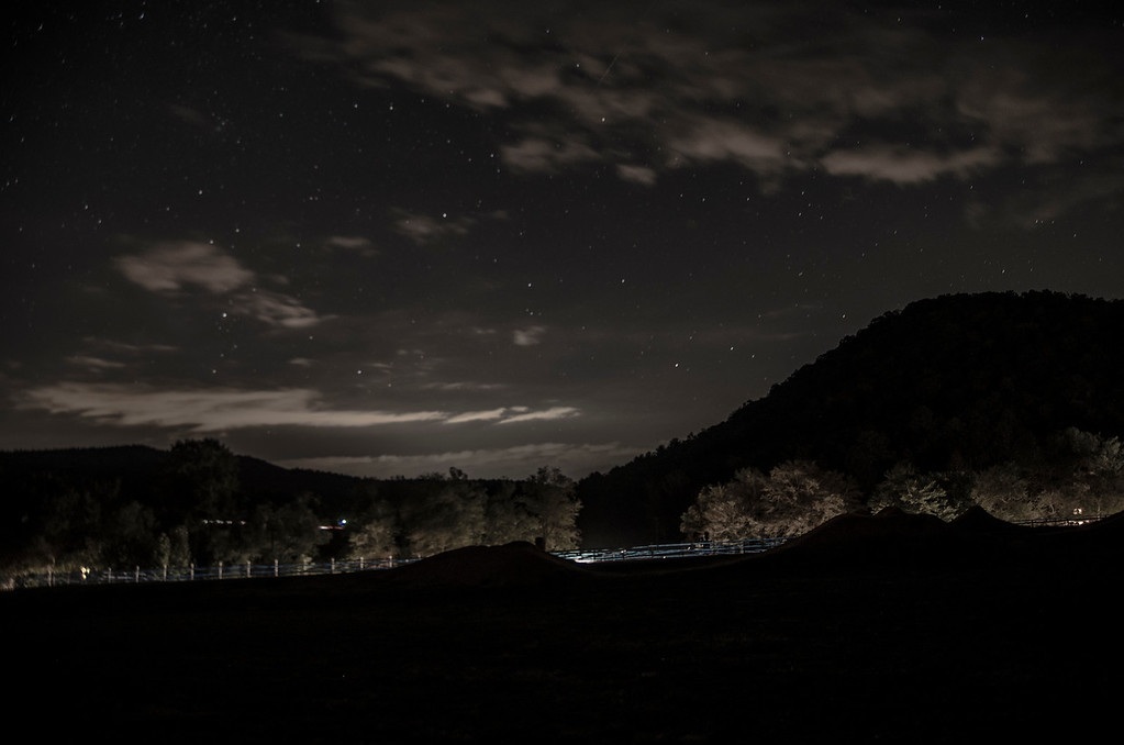 Night in the field at the Reeb Ranch.  Headlights light up the course tape for the next day's CX race.