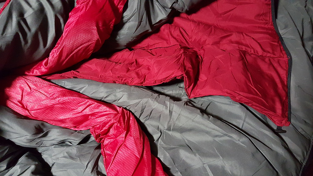 On the inside, the draft collar, and the insulated layer.  The insulated layer can be zipped or unzipped for comfort.