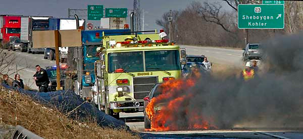 Kohler firefighters respond to the scene of a fully engulfed car fire on I-43 southbound at Highway PP that completely shut down southbound traffic for more than 15 minutes on Wednesday afternoon, March 19, 2008. Press photo/Sam Castro