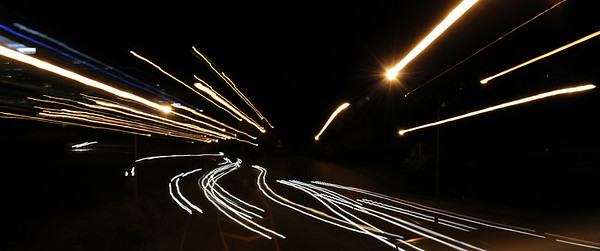Twisting the zoom during a long exposure of traffic coming and going
