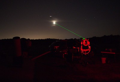 Possible Iridium Flare top left of Moon and a giant green laser