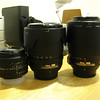 The lineup of lenses, left to right: Nikon 50mm f/1.8D, Nikon 18-135mm f/3.5-5.6, Nikon 55-200mm f4-5.6 VR.