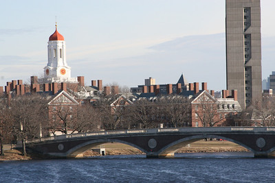 A view of the pedestrian bridge over the Charles River taken from the Harvard Bridge in Cambridge, MA.