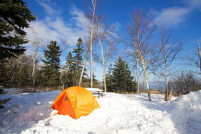 In the winter you can't stake your tent down because the ground is frozen. So you have to kick a little snow around the fly and within a short time it will hold it down even the strongest of wins.