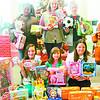 Girl Scout Troop 50163 members Haley J., Liz J., Jordyn S., Dasani T., Samantha B., and Abby M. drop off their donations.