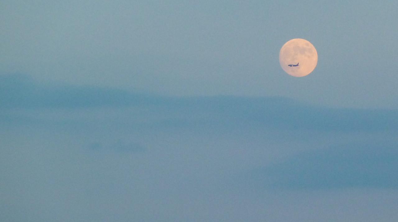 July 24, 2010.<br /> <br /> Plane passing the rising moon over the ocean at Fire Island Pines.<br /> <br /> This is the second of two photos I took and posted today.