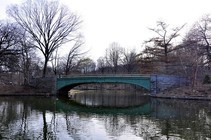 """3 April 2011.<br /> <br /> Bridge in Prospect Park, Brooklyn.<br /> <br /> It was in the 50's today, so I rode my bike to Prospect Park and rode around a loop in the park a couple of times and then rode around the neighborhood a bit. The park is about 2 miles from my condo. It's a nice park, but Central Park it's not.<br /> <br /> I was pulled over by the cops for briefly riding on the sidewalk near the park on my way home and almost got a ticket. I was lucky I didn't as there is a """"crackdown"""" on bicycle riders taking place. I only rode on the sidewalk for one block there because the streets around the entrance to the park are very heavily congested with cars and it's a big traffic circle that is a tad confusing."""